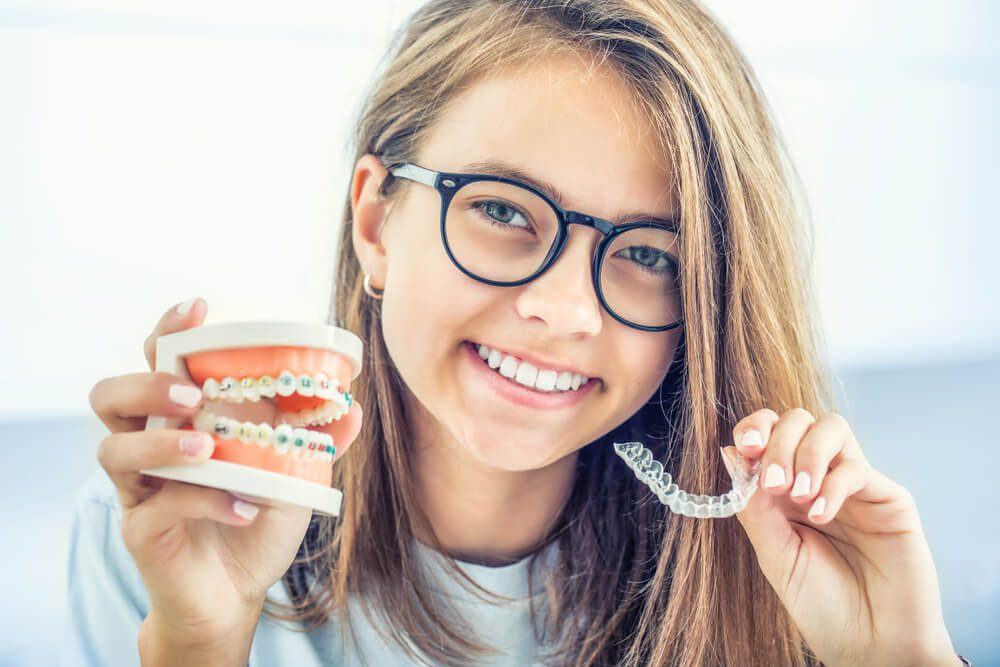 Orthodontic and quality of life: A little girl showing braces